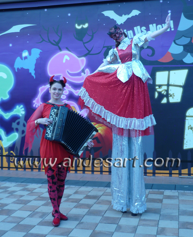 Halloween Accordionist and Stiltwalker